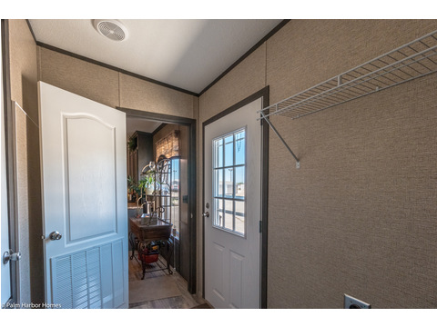 The utility room has a door that separates it from the main kitchen and living areas in the Homeland model ML30483H manufactured home by Palm Harbor Homes with 3 Bedrooms, 2 Baths, 1,440 Sq. Ft