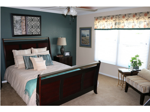The master bedroom is one to brag about! Look at all the space and that beautiful accent wall!!  The Landrace by Palm Harbor Homes - 3 Bedrooms, 2 Baths, 1920 Sq. Ft.