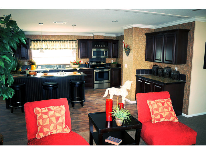 Beautiful View Of The Living Area Looking Into The Kitchen....notice The