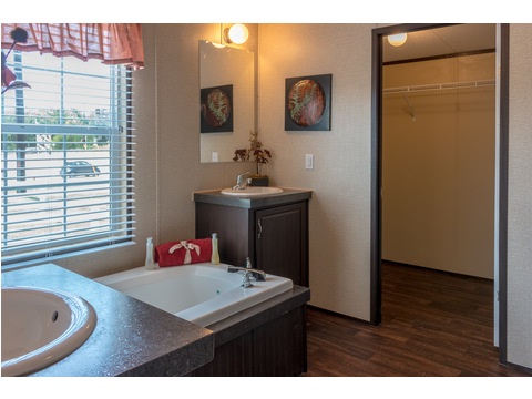 Master bedroom has a huge walk in closet in the in our Model 32523P manufactured home with 3 Bedrooms, 2 Baths, 1560 Sq. Ft.