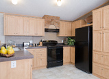 The Phoenix I kitchen. Picture of home by manufactured/modular builder Palm Harbor.