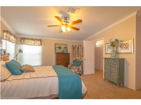 Beautiful master bedroom with many windows, a ceiling fan and also notice, the air vents are in the ceiling throughout this home. No more arranging furniture around those floor vents. - The Yukon KHT368A2 by Palm Harbor Homes