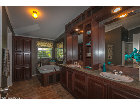 The master bathroom has everything you would ever wish for. HUGE soaker tub, walk-in shower, dual vanities (no more early morning traffic jams). A ton of counter-top and storage space, and much more! - The Yukon KHT368A2 by Palm Harbor Homes