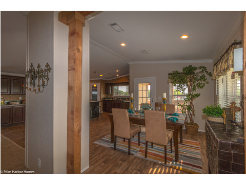 Dining area seen from the front entrance, showing the optional side door to the porch, excellent for entertaining.   - The Yukon KHT368A2 by Palm Harbor Homes