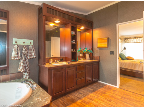 Beautiful built-ins over the master bathroom double vanity - The Yukon KHT368A2 by Palm Harbor Homes