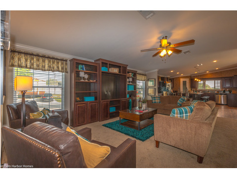 Look at this STUNNING home! Open-concept floor plan with huge windows allowing lots of natural lighting. With this giant built in entertainment system you won't be able to keep your friends out on game day! - The Yukon KHT368A2 by Palm Harbor Homes