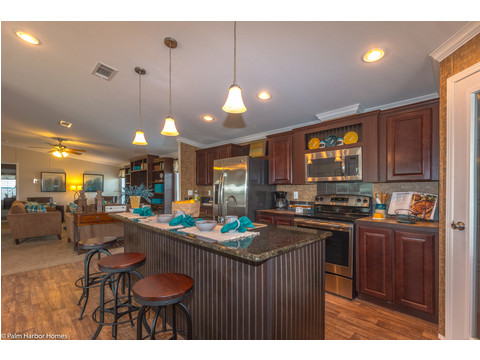 Drop lighting over the huge island, tile back-splash, TONS of cabinet and counter-top space, a huge walk-in pantry, the list goes on and on. This kitchen is simply amazing. - The Yukon KHT368A2 by Palm Harbor Homes