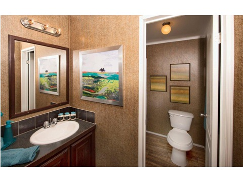 The second bathroom has a separate vanity area that maximizes its efficiency - The Yukon KHT368A2 by Palm Harbor Homes