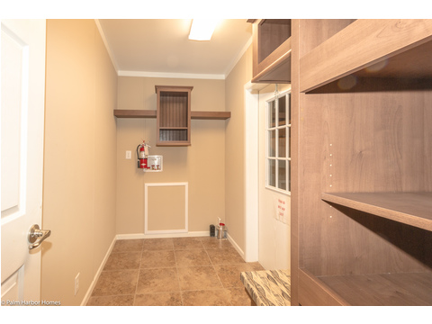 More great built in storage in this utility room - The Pelican Bay - Palm Harbor Manufactured Home in Florida - 3 Bedrooms, 2 Baths, 2,022 Sq. Ft. - 30' x 68'