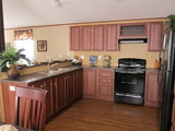 Large kitchen - The Phoenix II TLI476X6 by Palm Harbor Homes