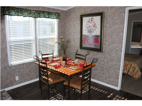 Dining area - The Home Box Office by Palm Harbor Homes