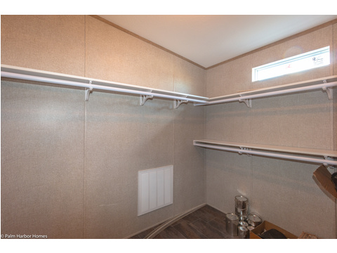 Walk-in closet in master bathroom - The Homerun ML30724R by Palm Harbor Homes