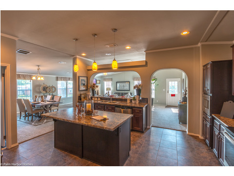 Walking into the kitchen from the front living area gives you a great view of the rest of the open-concept living area in the La Linda manufactured home by Palm Harbor with 3 Bedrooms, 2 Baths, 2280 Sq. Ft.