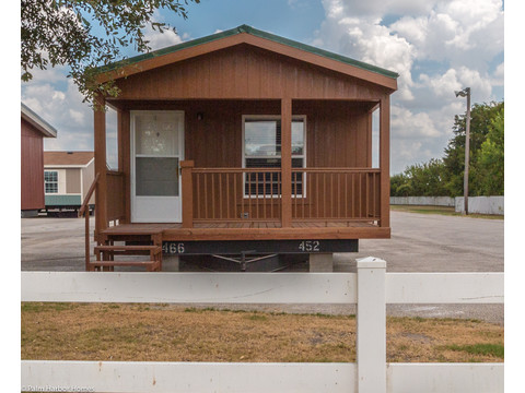 Looking for a tiny house with lots of room and a built-in porch? The Cabana III is perfect for down sizing, a first home or starter or a vacation cottage - Cabana III SM16612 manufactured cabin by Palm Harbor Homes with 2 Bedrms, 2 Baths, 868 Sq. Ft.