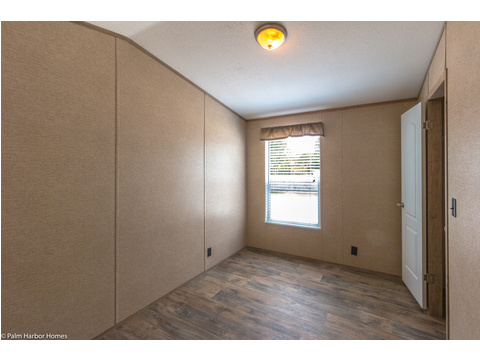 The 2nd bedroom here is perfect for bunkbeds, a queen bed or a home office with easy access to the bathroom and the rest of the features of the Cabana III by Palm Harbor Homes.