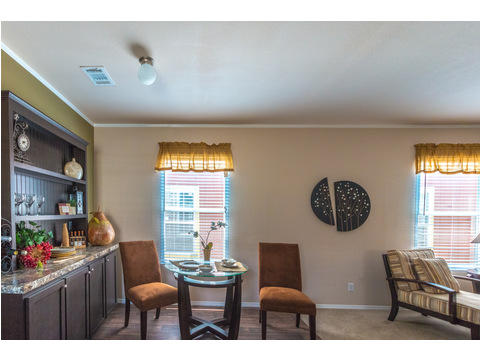 Open dining room with window in The Woodland II by Palm Harbor Homes - 3 Bedrooms, 2 Baths, 1,116 Sq. Ft.