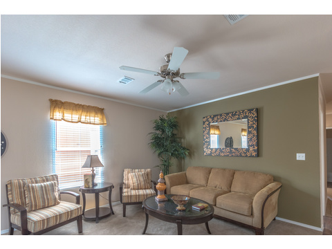 Room to seat everyone in the Living Room in The Woodland II by Palm Harbor Homes - 3 Bedrooms, 2 Baths, 1,116 Sq. Ft.