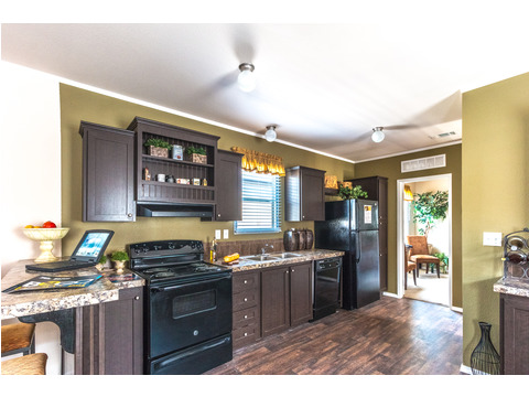 Large open kitchen in The Woodland II by Palm Harbor Homes - 3 Bedrooms, 2 Baths, 1,116 Sq. Ft.