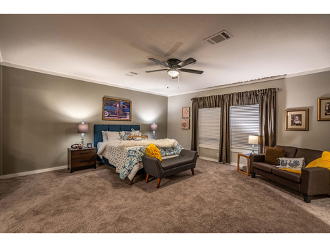 Master suite in the Magnum Home 76 double wide manufactured home by Palm Harbor Homes with 4 Bedrooms, 2 Baths, 2584 Sq. Ft.