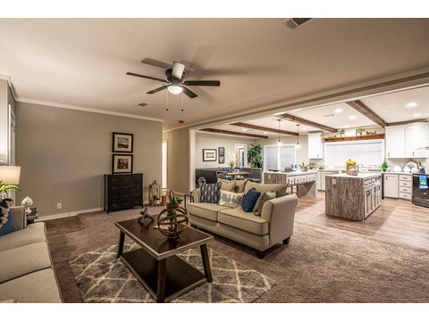 Living room in the Magnum 76 double wide manufactured home by Palm Harbor Homes with 4 Bedrooms, 2 Baths, 2584 Sq. Ft.