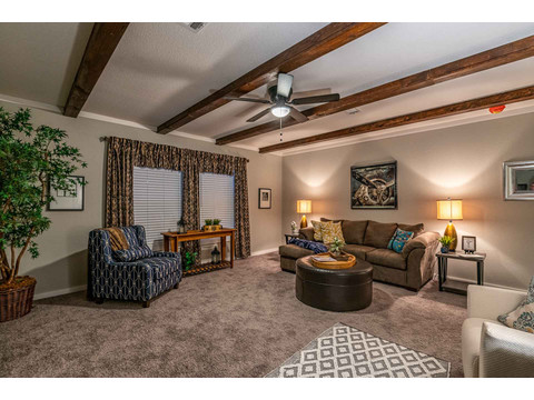 Family Room in the Magnum Home 76 double wide manufactured home by Palm Harbor Homes with 4 Bedrooms, 2 Baths, 2584 Sq. Ft.