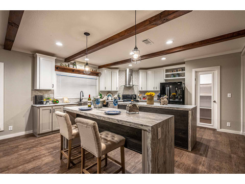 Open concept kitchen in the Magnum Home 76 manufactured home by Palm Harbor Homes with 4 Bedrooms, 2 Baths, 2584 Sq. Ft.