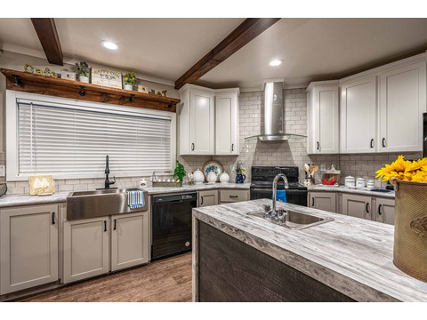 Open concept kitchen in the Magnum Home 76 double wide manufactured home by Palm Harbor Homes with 4 Bedrooms, 2 Baths, 2584 Sq. Ft.