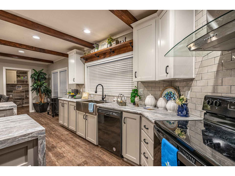 "Do you hate being ""cooped up"" in the kitchen to cook or clean up afterwards? Then the Magnum 76 is the right home for you because this kitchen is ""free range"" - - with tons of storage, counters, room to work and access to everyone else in the house!"