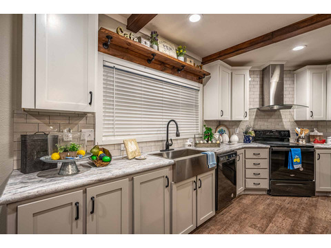 One more look at this gorgeous kitchen - - but there's more!  So keep clicking - - or go ahead and click the Availability link to find a store near you with a model of this The Magnum Home 76 double wide manufactured home.
