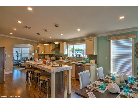 Dining area and kitchen - The Riviera II, 3 Bedroom, 2 Bath, 2,040 Sq. Ft. manufactured home by Palm Harbor in Plant City