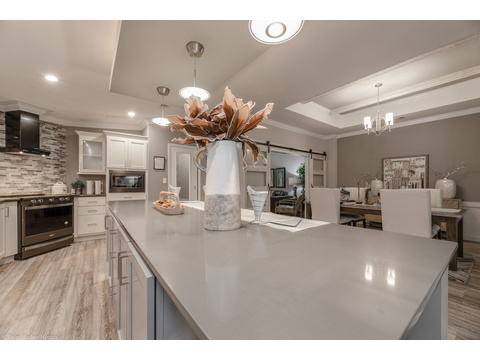 Massive counter space and room for multiple cooks - the La Belle IV X4769H in Florida - 4 Bedrooms, 3 Baths, 2,847 Sq. Ft. triple wide manufactured home or modular home by Palm Harbor Homes