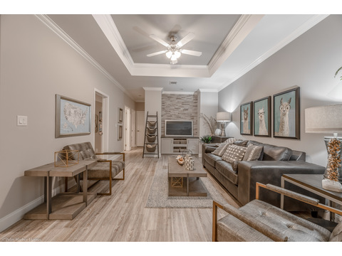 The media room or family room is directly behind the dining area's dramatic rolling doors in the he La Belle IV X4769H in Florida - 4 Bedrooms, 3 Baths, 2,847 Sq. Ft. triple wide manufactured home or modular home by Palm Harbor Homes