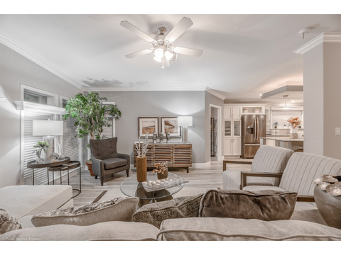 The open living area is to the left of the entrance in this version of the La Belle IV X4769H or TL40764B 4 Bedrooms, 3 Baths, 2,847 Sq. Ft. triple wide manufactured home or modular home by Palm Harbor Homes