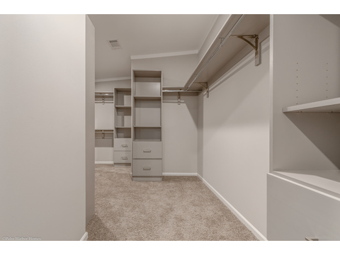 Even the spacious master closet has built ins in the La Belle IV X4769H in Florida - 4 Bedrooms, 3 Baths, 2,847 Sq. Ft. triple wide manufactured home or modular home by Palm Harbor Homes