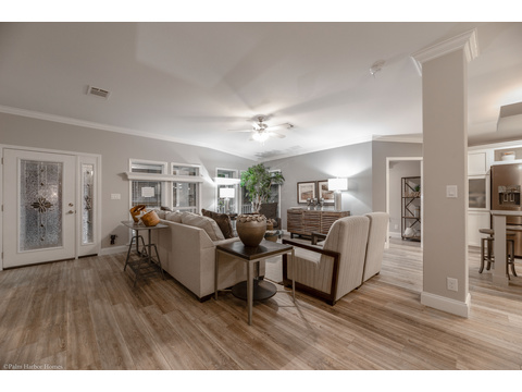The primary living area is just inside the front doors with lots of natural light in the he La Belle IV X4769H in Florida - 4 Bedrooms, 3 Baths, 2,847 Sq. Ft. triple wide manufactured home or modular home by Palm Harbor Homes