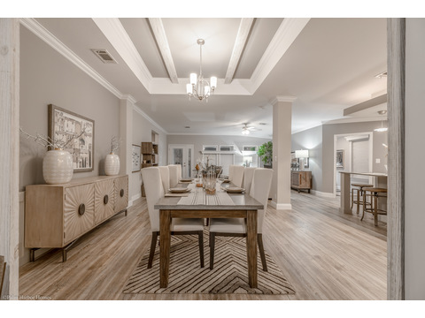 Standing behind the table in the dining room, you can see back into the entry area how open & airy the La Belle IV is - 4 Bedrooms, 3 Baths, 2,847 Sq. Ft. triple wide manufactured home or modular home by Palm Harbor Homes
