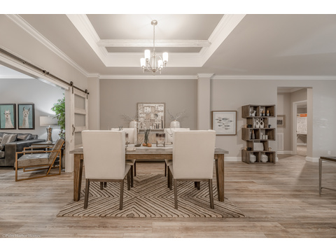 The dining room is adjacent to the media room or family room in the La Belle IV X4769H in Florida - 4 Bedrooms, 3 Baths, 2,847 Sq. Ft. triple wide manufactured home or modular home by Palm Harbor Homes