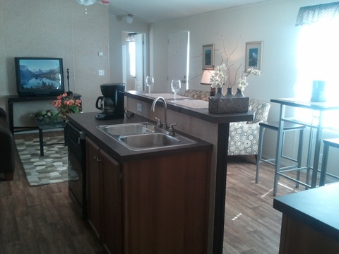 Work island and serving bar - The Cabana TLG256T9 by Palm Harbor Homes