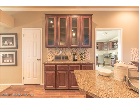 Built-in buffet in kitchen - Hacienda II by Palm Harbor Homes