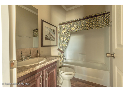 Secondary bathroom off the Play Room / Study. This home has 4 bedrooms and 3 bathrooms. - The Hacienda II by Palm Harbor Homes
