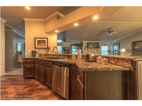 Spacious kitchen counter and entertaining bar - Hacienda II by Palm Harbor Homes