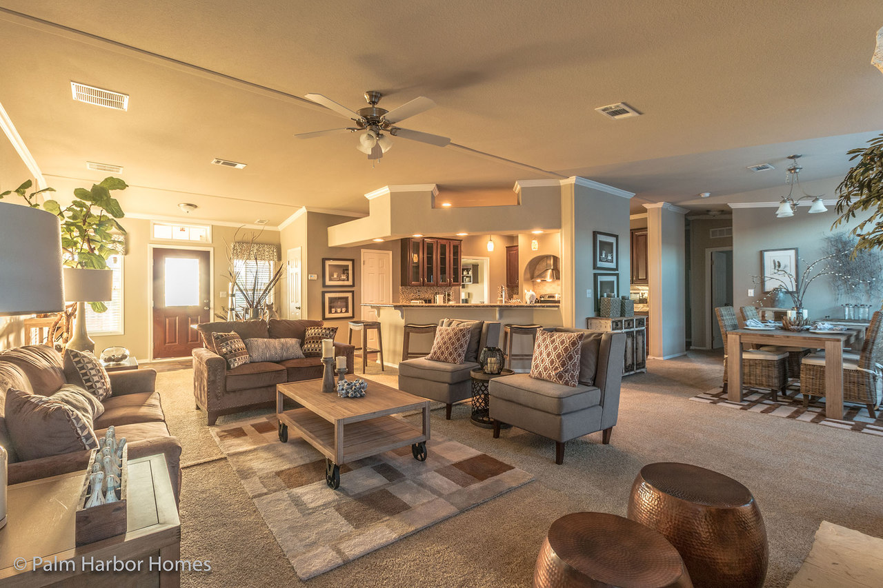 View the hacienda ii floor plan for a 2580 sq ft palm for House plans with fireplace in center of house