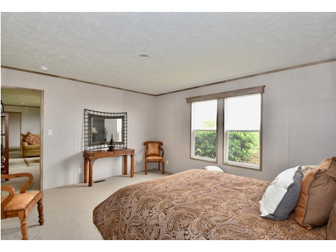 Master bedroom in the VU28563U - 1493 sq ft by Palm Harbor Homes.