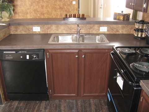 Notice the stainless steel residential size sink. Lifetime Warrantied Moen Faucets throughout. Name Brand GE appliances including dishwasher.  - The Slant Kitchen TLG376B9 by Palm Harbor Homes