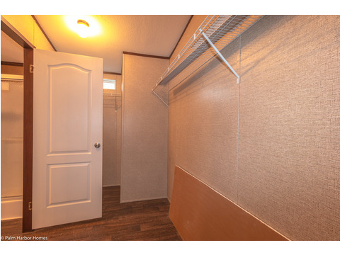 Walk-in closet in master bath - The Builtmore HPT476X5 by Palm Harbor Homes