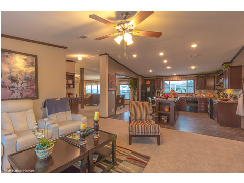 Family room with kitchen and living room in the background - The Builtmore HPT476X5 by Palm Harbor Homes