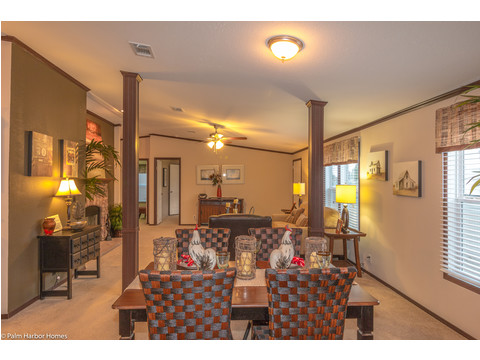 Dining area overlooking the living room - The Builtmore HPT476X5 by Palm Harbor Homes