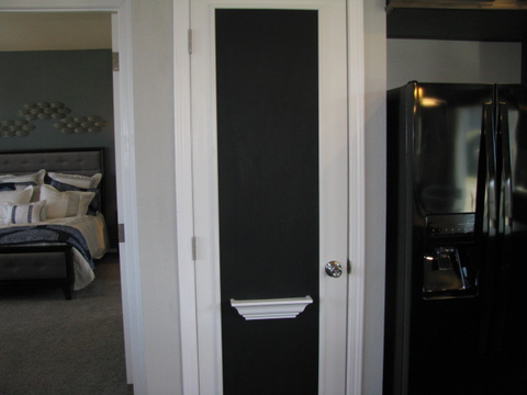Pantry with Chalk Board Door - The Casa Grande AD28764A by Palm Harbor Homes