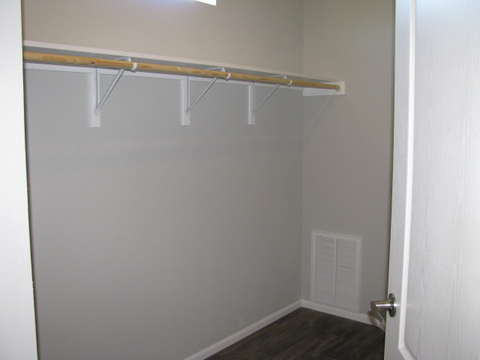 Walk-in closet in master suite - The Casa Grande AD28764A by Palm Harbor Homes