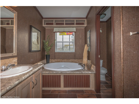 After a long day there is nothing like relaxing in The Great Escape by Palm Harbor Homes with a cold beverage in your very own soaker tub...
